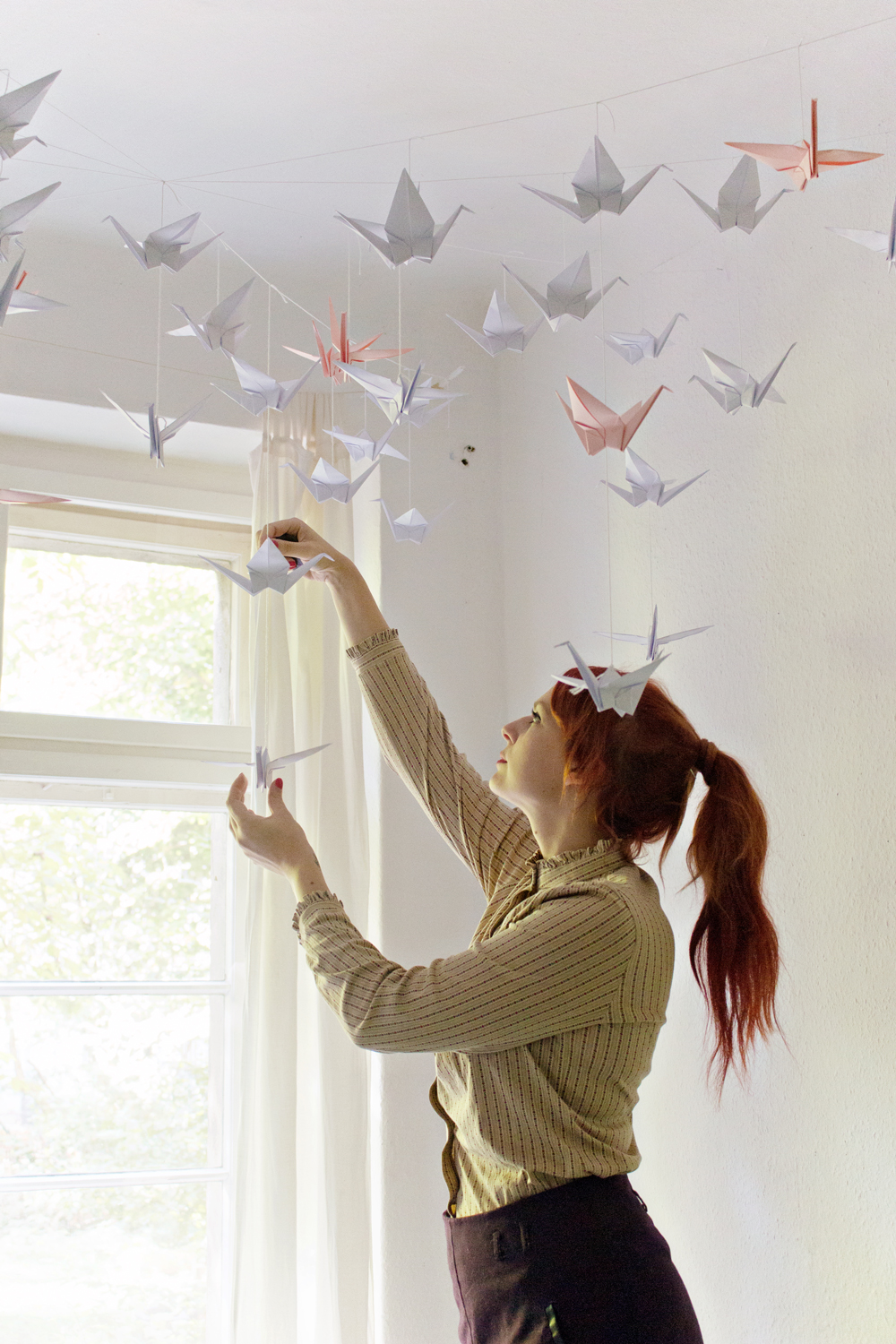 How To Make Paper Christmas Ceiling Decorations : Diy renters friendly origami ceiling decoration